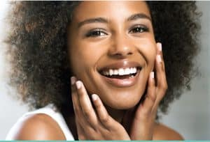 black woman smiling - hydroserum